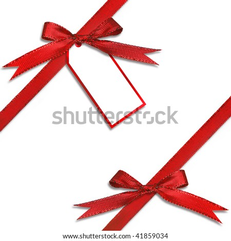 Christmas Gift Tag Hanging from a Present With Tied Red Bow - stock photo