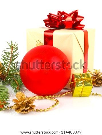Christmas gift, white box with red bow, fir branch and balls, New Year holiday photo