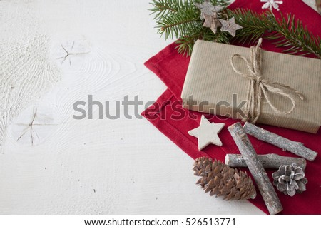 Christmas gift with christmas decoration on white wood background