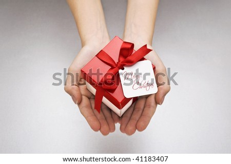 christmas gift with decorative red ribbon bow - stock photo