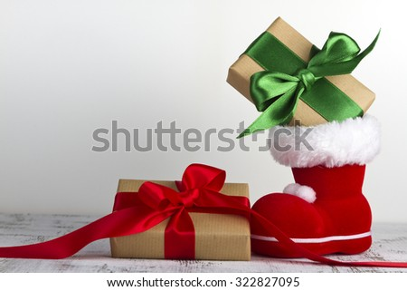 Christmas gift with red and green bow - stock photo