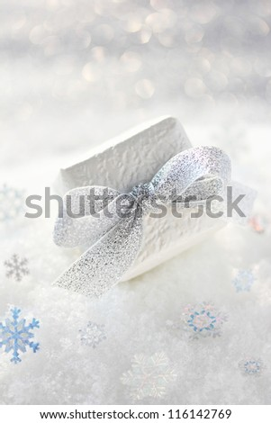 Christmas gift with snowflakes on snow - stock photo