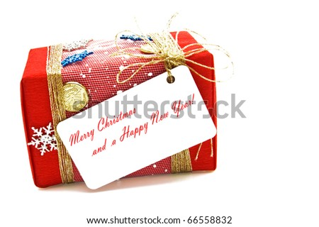Christmas gift with tag. - stock photo