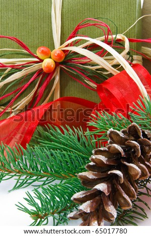 Christmas Gift Wrapped In Recycled Paper - stock photo