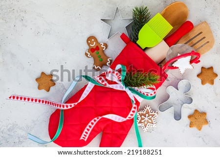 Christmas gift wrapping idea  with oven mitt,kitchen utensils and cookies - stock photo