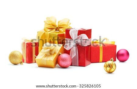 Christmas gifts and baubles on white background - stock photo