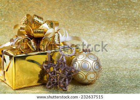 Christmas gifts and decorations on a yellow background