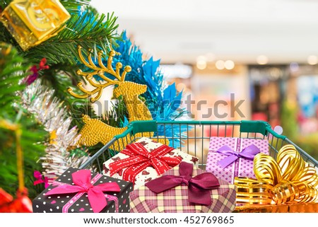 Christmas gifts and presents in shopping trolley  - stock photo