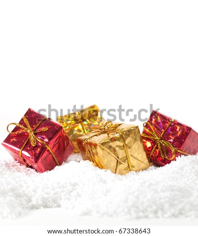Christmas gifts  and snow background - stock photo