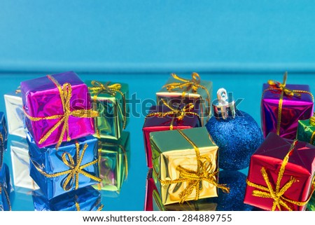 Christmas gifts and toys on a blue background - stock photo