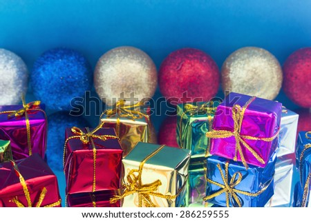 Christmas gifts and toys on a mirror - stock photo