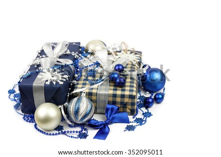 Christmas gifts boxes and blue, silver balls  - stock photo