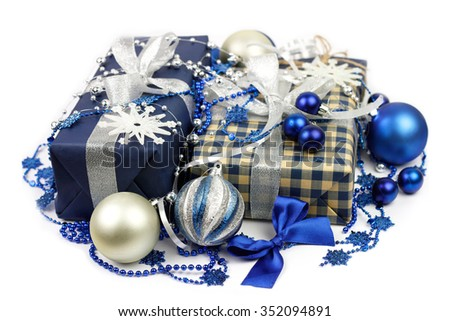 Christmas gifts boxes and blue, silver balls closeup - stock photo