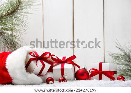 Christmas gifts,fir branch on wood plank. - stock photo