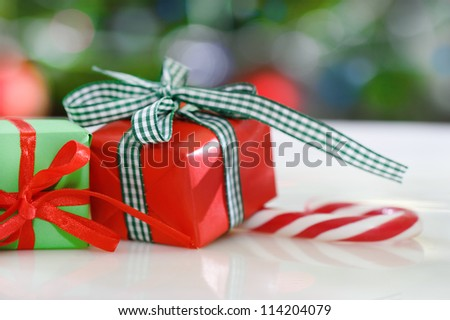 Christmas gifts in front of Christmas tree for the holidays - stock photo