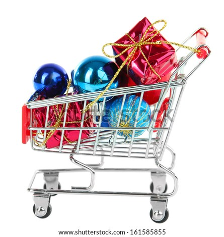 Christmas gifts in shopping trolley, isolated on white - stock photo