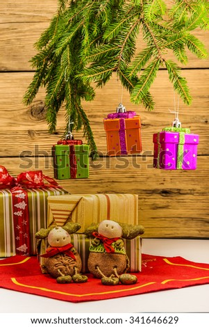 Christmas gifts on a wall of the of old boards