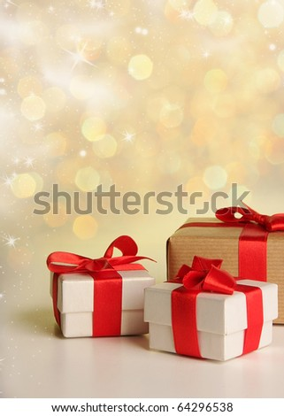 Christmas gifts on snow background - stock photo