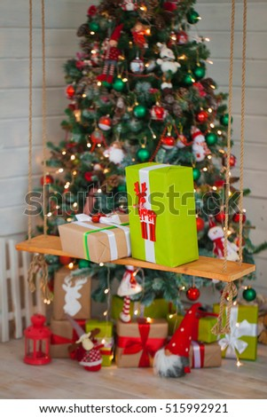 Christmas gifts on the background of trees. Home Decor in Christmas
