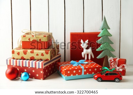 Christmas gifts on wooden background - stock photo
