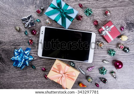 Christmas gifts on wooden background. Holiday image for New Year and Christmas. Vintage texture for design uses. - stock photo