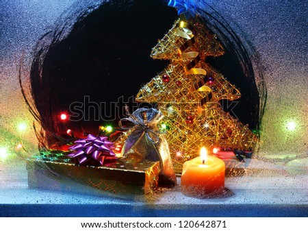 Christmas gifts still-life inside snowy window