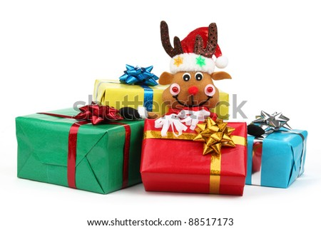 Christmas gifts with cute toy isolated on white.