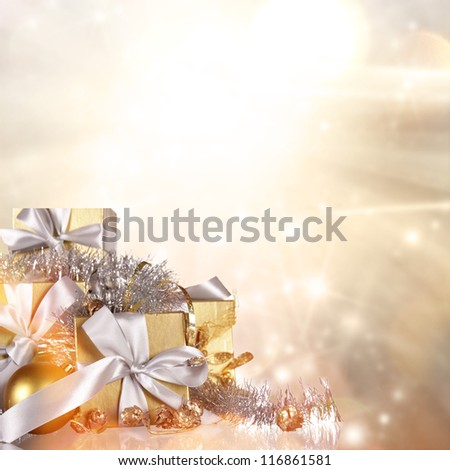 Christmas gifts with shining background - stock photo