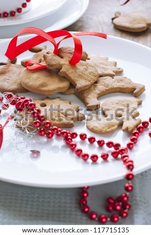 Christmas Ginger Breads with Red Ribbon at the White Plate