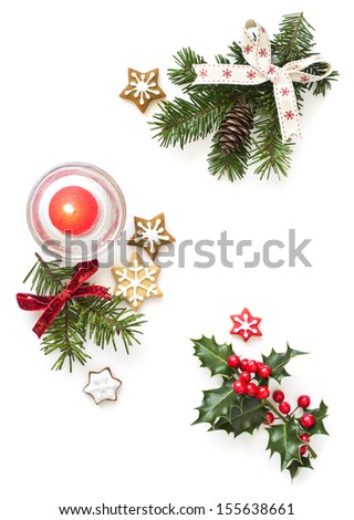 Christmas ginger cookies and holly decoration. Isolated on white background. - stock photo