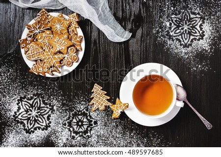 Christmas gingerbread and cup of tea with snowflakes decorations
