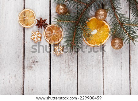Christmas gingerbread and dried oranges on the table, top view - stock photo