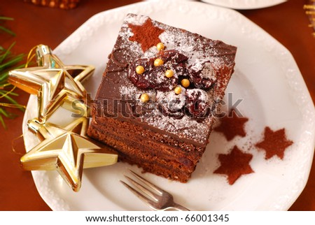 christmas gingerbread cake with chocolate cream and cherry - stock photo