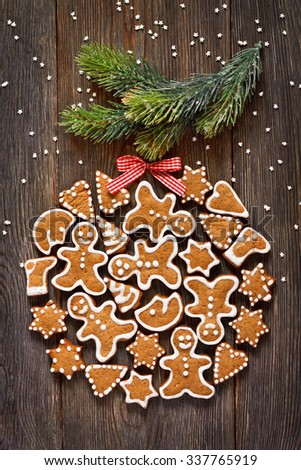 Christmas gingerbread cookie bauble hanging on Christmas tree branch. - stock photo