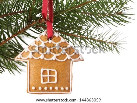 Christmas gingerbread cookie hanging on branch. - stock photo