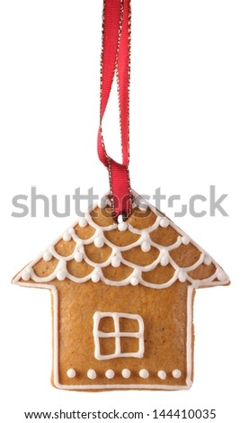 Christmas gingerbread cookie hanging on white background - stock photo