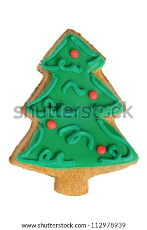 Christmas gingerbread cookie made in the shape of a Christmas tree isolated on a white background - stock photo