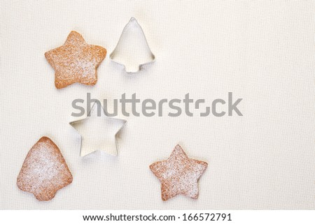 Christmas gingerbread cookies and cookie cutters on white - stock photo
