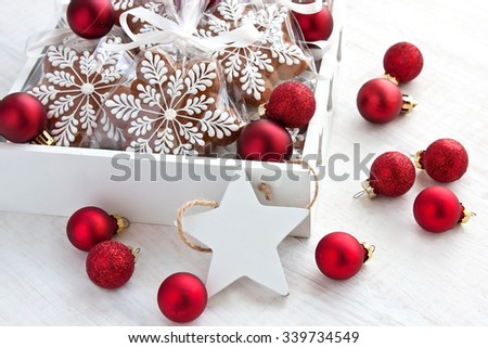 Christmas gingerbread cookies and decoration  on wooden background - stock photo