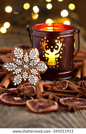 Christmas gingerbread cookies and lantern  on wooden background