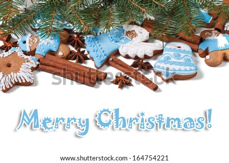 Christmas gingerbread cookies, cinnamon and fir twigs isolated on white background. Merry Christmas card - stock photo