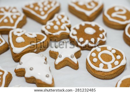 Christmas Gingerbread Cookies homemade different forms on wooden table. - stock photo