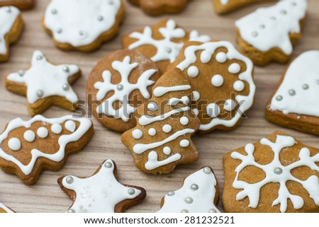 Christmas Gingerbread Cookies homemade on wooden table. - stock photo