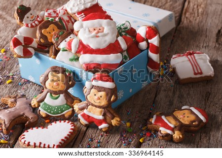 Christmas gingerbread cookies in a gift box on a table close-up. horizontal - stock photo