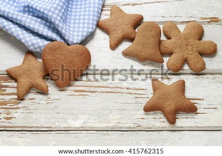 Christmas gingerbread cookies on a white wooden background