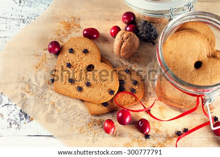 Christmas gingerbread cookies on old white wooden background, selective focus - stock photo