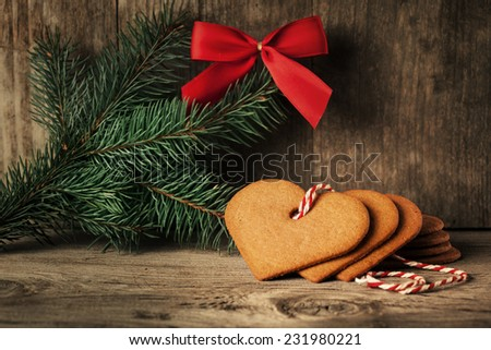 Christmas gingerbread cookies on old wooden background