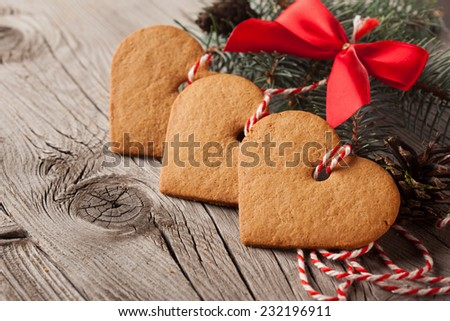 Christmas gingerbread cookies on old wooden background - stock photo
