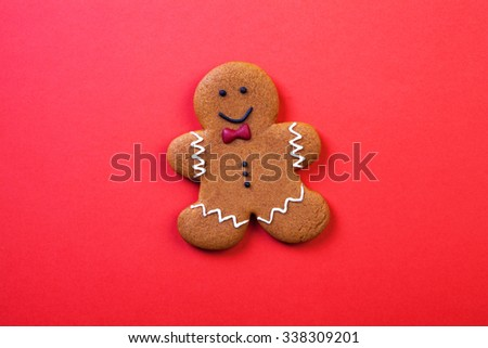 Christmas gingerbread cookies on red background.