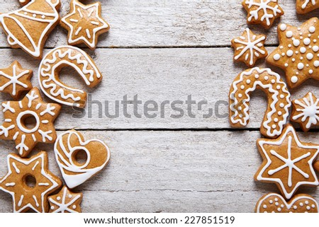 Christmas gingerbread cookies on white table - stock photo